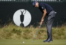 Matt Kuchar of the U.S. putts on the third green during a practice round ahead of the British Open Championship at the Royal Liverpool Golf Club in Hoylake, northern England July 16, 2014. REUTERS/Stefan Wermuth