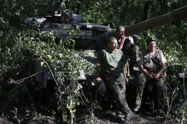 Pro-Russian separatists from the Vostok (East) battalion sit on a T-64 tank in Donetsk, eastern Ukraine, July 16, 2014.    REUTERS/Maxim Zmeyev