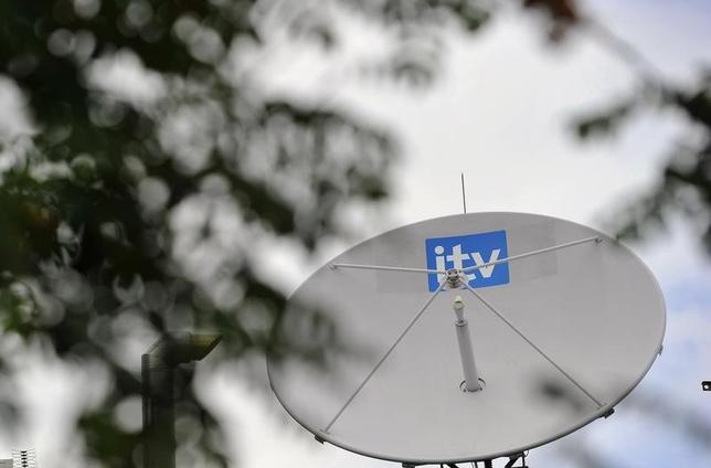 A satellite dish is seen on the roof of ITV television studios in central London August 3, 2010.   REUTERS/Toby Melville