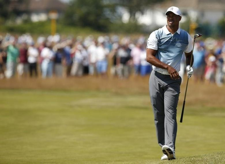 Tiger Woods of the U.S. watches his second shot on the 16th hole during the first round of the British Open Championship at the Royal Liverpool Golf Club in Hoylake, northern England July 17, 2014.        REUTERS/Cathal McNaughton