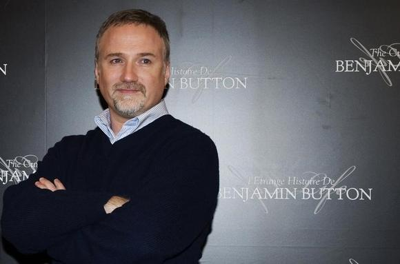 Director David Fincher poses for photographers during a photocall for his film ''The Curious Case of Benjamin Button'' in Paris January 22, 2009. REUTERS/Gonzalo Fuentes/Files
