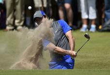 Rory McIlroy of Northern Ireland hits from a bunker on the 16th hole during the first round of the British Open Championship at the Royal Liverpool Golf Club in Hoylake, northern England July 17, 2014.  REUTERS/Toby Melville