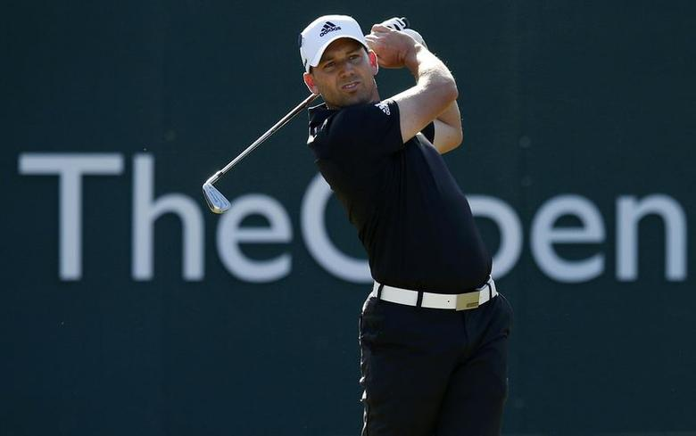 Sergio Garcia of Spain watches his tee shot on the first hole during the first round of the British Open Championship at the Royal Liverpool Golf Club in Hoylake, northern England July 17, 2014.      REUTERS/Cathal McNaughton