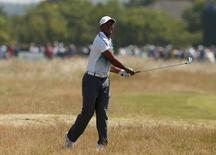 Tiger Woods of the U.S. watches his second shot on the 17th hole during the first round of the British Open Championship at the Royal Liverpool Golf Club in Hoylake, northern England July 17, 2014.REUTERS/Cathal McNaughton