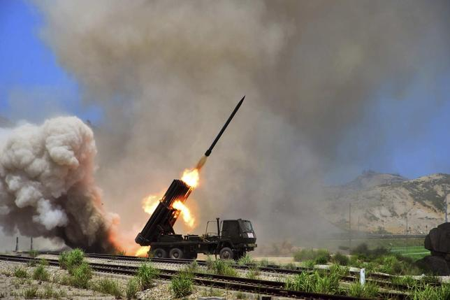 A view of a multiple rocket launcher during an exercise in this undated photo released by North Korea's Korean Central News Agency (KCNA) in Pyongyang July 15, 2014. REUTERS/KCNA