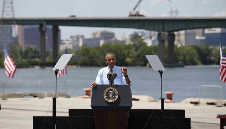 U.S. President Barack Obama speaks about transportation infrastructure during a visit to the Port of Wilmington in Wilmington, Delaware  July 17, 2014.  REUTERS/Kevin Lamarque