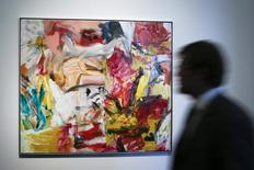 "A man walks past ""Untitled"" by Willem De Kooning during a preview of Sotheby's impressionist and modern art evening sale in New York, May 2, 2014. REUTERS/Eduardo Munoz"