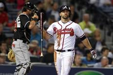 Atlanta Braves second baseman Dan Uggla (26) reacts after striking out against the Miami Marlins in the fifth inning at Turner Field. Apr 22, 2014; Atlanta, GA, USA; Brett Davis-USA TODAY Sports
