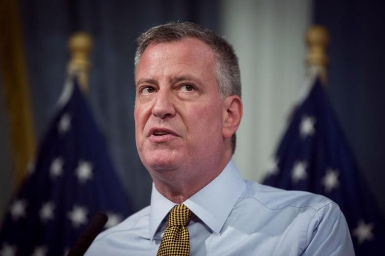 New York City mayor Bill de Blasio speaks about the city's emergency preparedness for a summer storm bearing down on New York, at an official weigh in for the Nathan's Famous Fourth of July International Hot Dog Eating Contest at City Hall in New York July 3, 2014 file photo.  REUTERS/Lucas Jackson