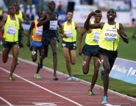 Silas Kiplagat of Kenia celebrates as he crosses the finish line in the men's 1500m event during during the Golden Gala IAAF Diamond League at the Olympic stadium in Rome June 5, 2014. REUTERS/Max Rossi