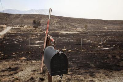 Washington state wildfire destroys 100 homes, hundreds...