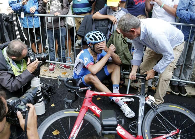 Garmin-Sharp team rider Jack Bauer of New Zealand reacts after crossing the finish line of the 222-km 15th stage of the Tour de France cycling race between Tallard and Nimes, July 20, 2014.   REUTERS/Jean-Paul Pelissier