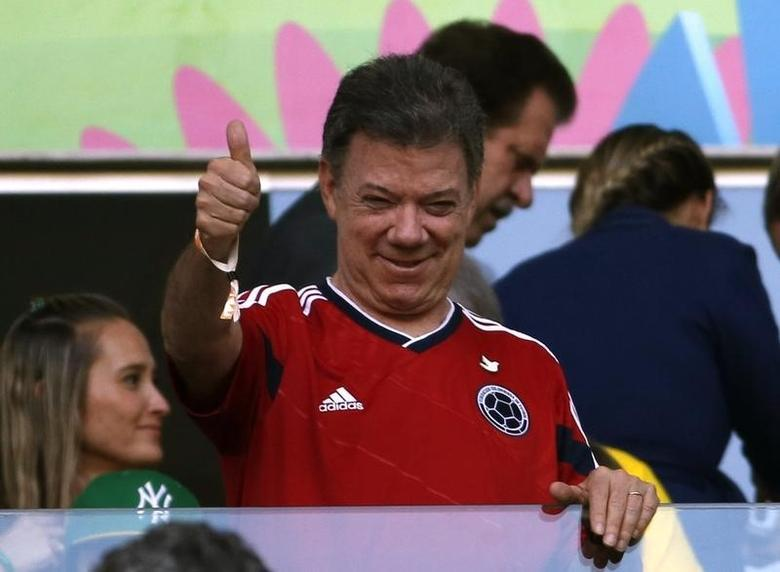 Colombia President Juan Manuel Santos gives a thumbs up during the 2014 World Cup quarter-finals between Brazil and Colombia at the Castelao arena in Fortaleza July 4, 2014. REUTERS/Jorge Silva