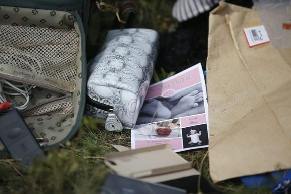 Belongings found at the crash site of Malaysia Airlines Flight MH17 are pictured near the village of Hrabove, Donetsk region, July 20, 2014. REUTERS/Maxim Zmeyev