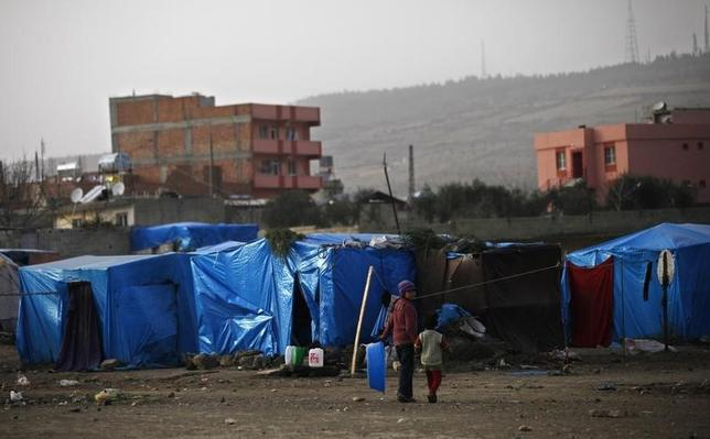Syrian refugee children walk outside their tents in the southeastern city of Kilis, near the Syrian-Turkish border, March 2, 2014. REUTERS/Nour Kelze