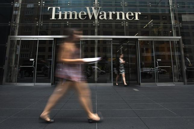 A woman walks past the Time Warner Center near Columbus Circle in Manhattan, New York July 16, 2014. REUTERS/Adrees Latif