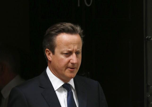 Britain's Prime Minister David Cameron leaves Downing Street in London July 21, 2014. REUTERS/Luke MacGregor