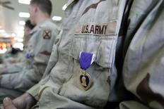 A Purple Heart medal on the chest of a soldier during a ceremony at Camp Liberty in Baghdad, Iraq, April 12, 2005. REUTERS/Gerald Herbert/Pool