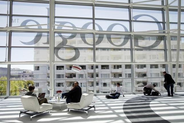 Attendees sits in front of a Google logo during Google I/O Conference at Moscone Center in San Francisco, California June 28, 2012. REUTERS/Stephen Lam/Files