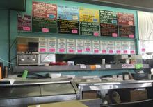The menu featuring specials and standard dishes is seen in Jumbo's Restaurant located in Miami's Liberty City area, in this picture taken July 22, 2014.   REUTERS/Zachary Fagenson