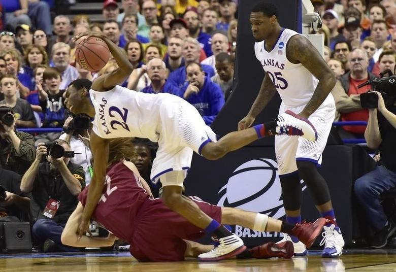 Kansas Jayhawks guard Andrew Wiggins (22) battles for a loose ball with Eastern Kentucky Colonels forward Eric Stutz (42) in the second half during the 2nd round of the 2014 NCAA Men's  Basketball Championship at Scottrade Center. Mar 21, 2014; St. Louis, MO, USA; Scott Rovak-USA TODAY Sports