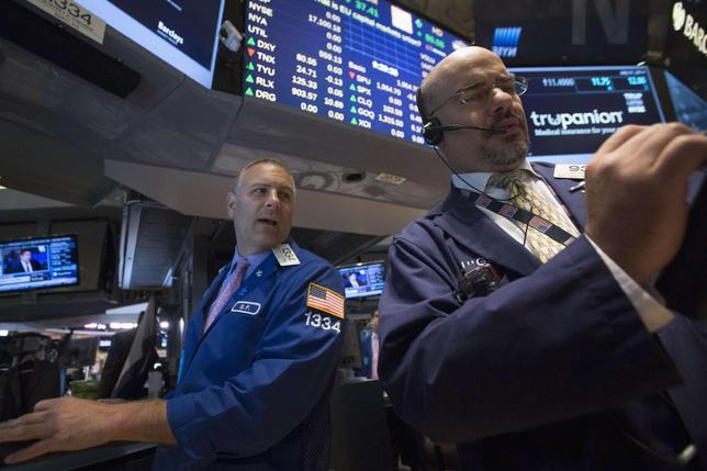 Specialist trader Geoffrey Friedman (L)  gives a price just after the opening bell on the floor of the New York Stock Exchange July 21, 2014. REUTERS/Brendan McDermid