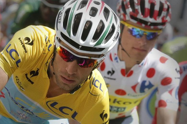 Race leader Astana team rider Vincenzo Nibali of Italy (L) and best climber Tinkoff-Saxo rider Rafal Majka of Poland, compete in the 124.5km 17th stage of the Tour de France cycle race between Saint-Gaudens and Saint-Lary Pla d'Adet, July 23, 2014.    REUTERS/Christian Hartmann
