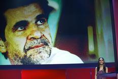 Integrante do júri do Festival de Berlim ao lado de foto do diretor iraniano Jafar Panahi. 16/02/2013. REUTERS/Fabrizio Bensch