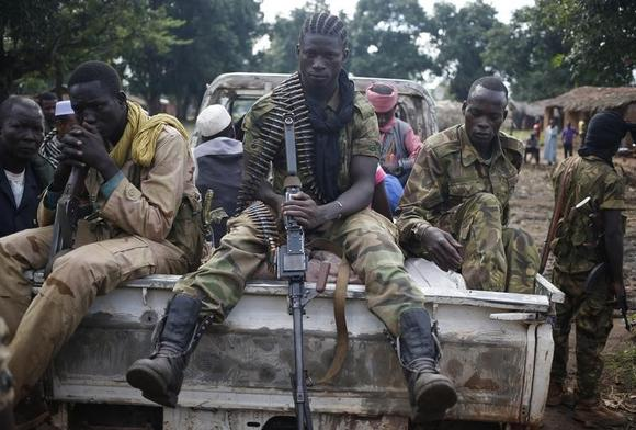 Seleka fighters take a break as they sit on a pick-up truck in the town of Goya June 11, 2014. REUTERS/Goran Tomasevic