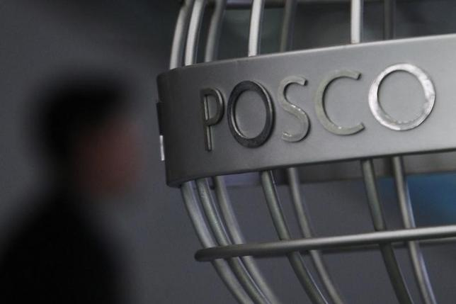 A man walks past a POSCO logo at the company's headquarters in Seoul April 22, 2011. POSCO, the world's No. 3 steelmaker, reported a 36 percent fall in quarterly operating profit, missing forecasts, hit by high raw materials costs and low demand. REUTERS/Truth Leem