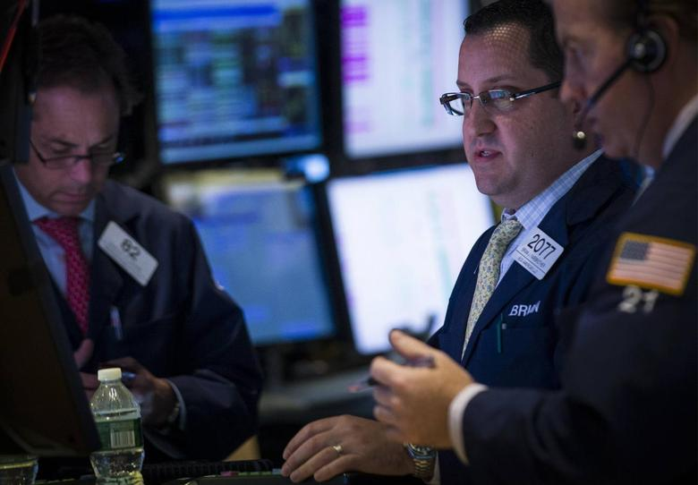Traders work on the floor of the New York Stock Exchange July 21, 2014. REUTERS/Brendan McDermid