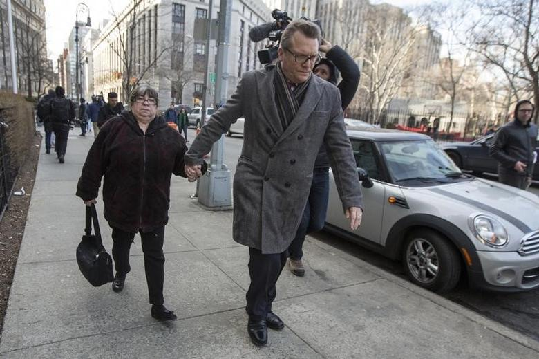 Annette Bongiorno (L), former portfolio manager for Bernard L. Madoff Investment Securities LLC, exits the Manhattan Federal Court house in New York, March 24, 2014.  REUTERS/Brendan McDermid