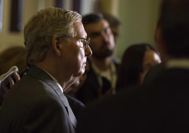 Senate Minority Leader Mitch McConnell (R-KY) listens to members of the Republican Senate leadership after the Republican caucus meeting on Capitol Hill in Washington July 8, 2014 file photo.     REUTERS/Joshua Roberts