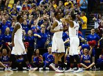 Kansas Jayhawks guard Andrew Wiggins (22) is congratulated by Wayne Selden, Jr. (1) against the Eastern Kentucky Colonels in the second half during the 2nd round of the 2014 NCAA Men's Basketball Championship at Scottrade Center. Mar 21, 2014; St. Louis, MO, USA; Jasen Vinlove-USA TODAY Sports