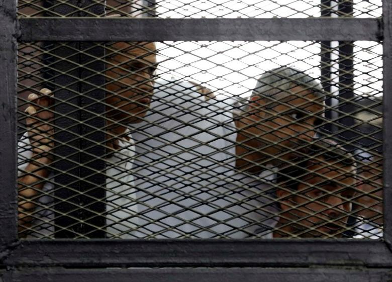 Peter Greste, Mohamed Fahmy and Baher Mohamed (L to R), listen to the ruling at a court in Cairo June 23, 2014 file photo.   REUTERS/Asmaa Waguih