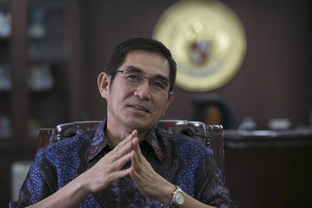 The head of Indonesia's Constitutional Court Hamdan Zoelva speaks with Reuters during an interview in his office in Jakarta July 24, 2014.  REUTERS/Darren Whiteside