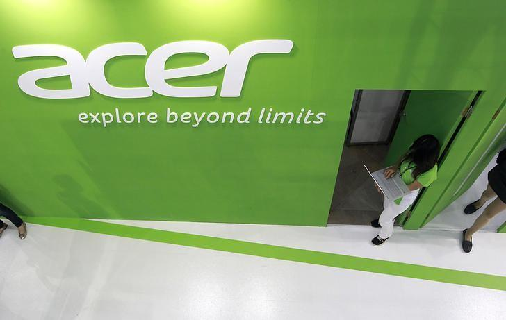 An employee uses an Acer laptop at the company's booth during the 2014 Computex exhibition at the TWTC Nangang exhibition hall in Taipei June 3, 2014. REUTERS/Pichi Chuang/Files