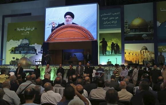 Lebanon's Hezbollah leader Sayyed Hassan Nasrallah makes a rare public appearance as he addresses his supporters during a rally to mark ''Quds (Jerusalem) Day'' in Beirut's southern suburbs July 25, 2014. REUTERS/Sharif Karim