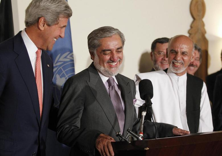 U.S. Secretary of State John Kerry (L) and Afghanistan's presidential candidates Abdulah Abdullah (C) and Ashraf Ghani (R) smile together after announcing a deal for the auditing of all Afghan election votes at the United Nations Compound in Kabul, late July 12, 2014 file photo. REUTERS/Jim Bourg