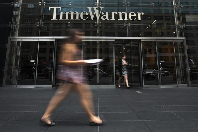A woman walks past the Time Warner Center near Columbus Circle in Manhattan, New York July 16, 2014. REUTERS/Adrees Latif