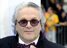"Director George Miller arrives at the premiere of ""Happy Feet Two"" in the Hollywood area of Los Angeles, California, November 13, 2011. REUTERS/Gus Ruelas"