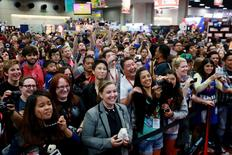 The crowd cheers at an autograph signing session during the 2014 Comic-Con International Convention in San Diego, California July 26, 2014. REUTERS/Sandy Huffaker