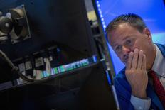A trader watches his screen on the floor of the New York Stock Exchange July 23, 2014. REUTERS/Brendan McDermid
