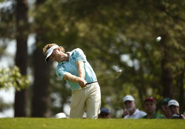 Former Master champion Bernhard Langer of Germany hits his tee shot on the fourth hole during the third round of the Masters golf tournament at the Augusta National Golf Club in Augusta, Georgia April 12, 2014. REUTERS/Jim Young
