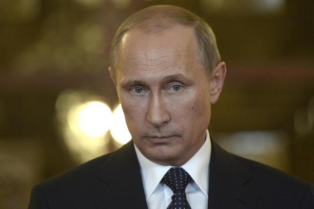 Russia's President Vladimir Putin talks to reporters during a meeting in Brasilia July 16, 2014. REUTERS/Alexei Nikolskyi/RIA Novosti/Kremlin