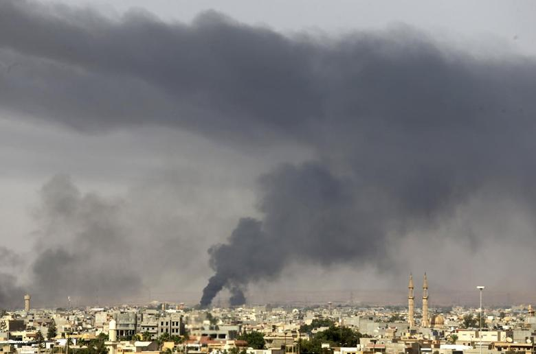 Black plumes of smoke is seen in the vicinity of Camp Thunderbolt, after clashes between militants, former rebel fighters and government forces in Benghazi July 27, 2014.  REUTERS/Esam Omran Al-Fetori
