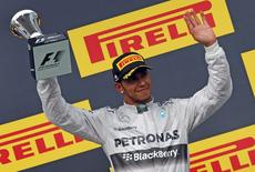 Third placed Mercedes Formula One driver Lewis Hamilton of Britain celebrates after the Hungarian F1 Grand Prix at the Hungaroring circuit, near Budapest July 27, 2014.  REUTERS/Laszlo Balogh