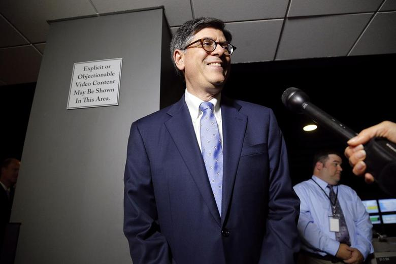 U.S. Treasury Secretary Jack Lew stops for a question from a reporter during a cybersecurity-related tour of a Verizon network operations center at their facility in Ashburn, Virginia July 15, 2014. REUTERS/Jonathan Ernst