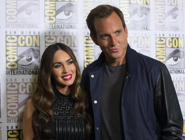 Cast members Megan Fox and Will Arnett pose at a press line for the movie ''Teenage Mutant Ninja Turtles'' during the 2014 Comic-Con International Convention in San Diego, California July 24, 2014.  REUTERS/Mario Anzuoni