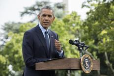 Президент США Барак Обама на пресс-конференции в Белом доме в Вашингтоне 29 июля 2014 года. Президент США Барак Обама объявил во вторник о расширении экономических санкций против России за ее роль в конфликте на Украине, однако отмел предположение, что нарастающая напряженность в отношениях с Москвой знаменует начало новой холодной войны. REUTERS/Joshua Roberts